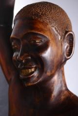 """<h5>""""Man and Drum"""" by D. Leconte (N/D)</h5><p>Approx. 69″ L/D; Wooden sculpture BMAS N/N</p>"""